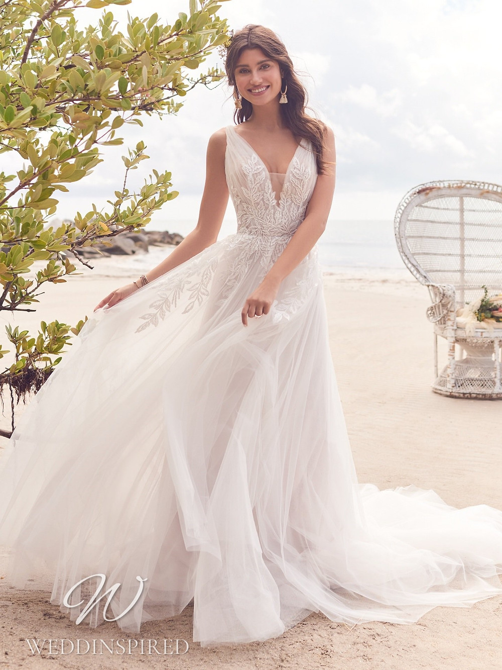 A Rebecca Ingram 2021 lace and tulle A-line wedding dress
