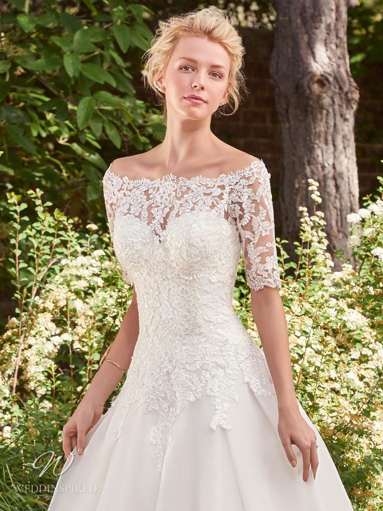 A Rebecca Ingram 2020 off the shoulder lace and crepe A-line wedding dress with half sleeves
