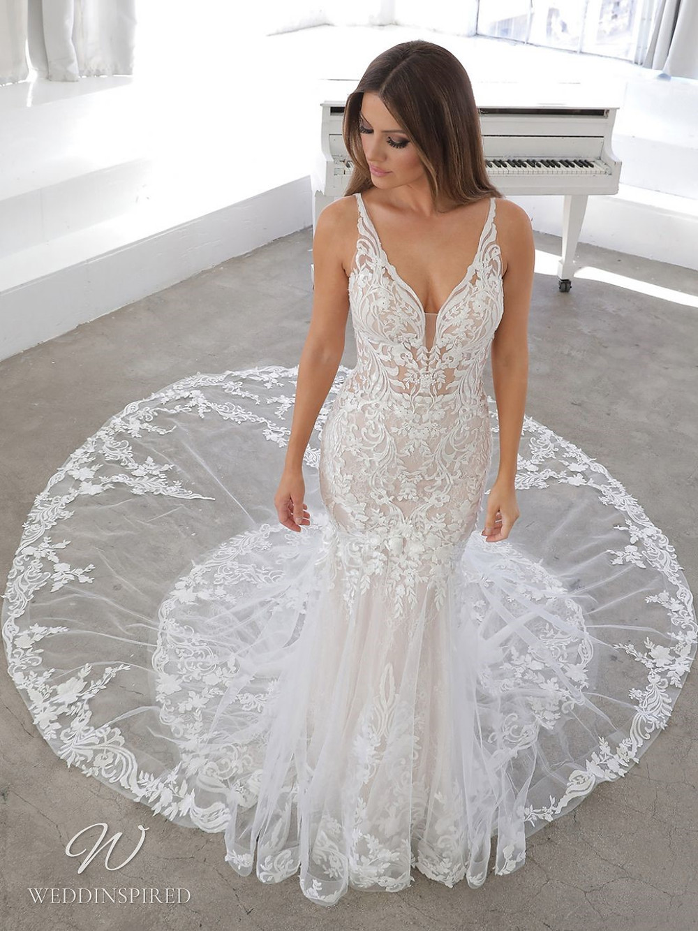 A Blue by Enzoani 2021 lace mermaid wedding dress with straps and a v neck