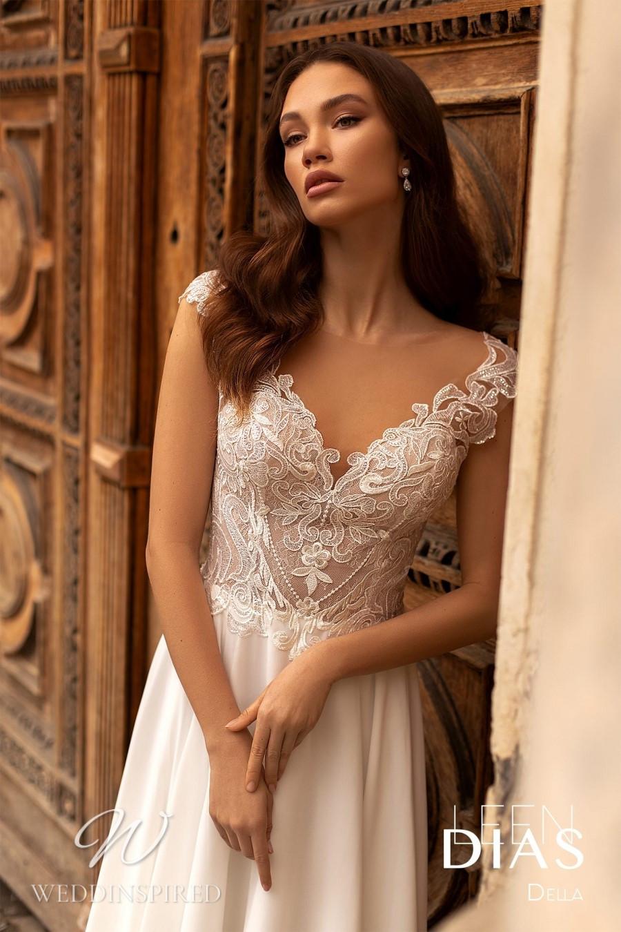 A Leen Dias 2021 lace and satin sheath wedding dress