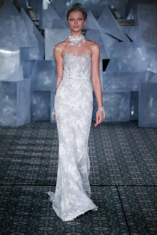 A Mira Zwillinger strapless lace column wedding dress