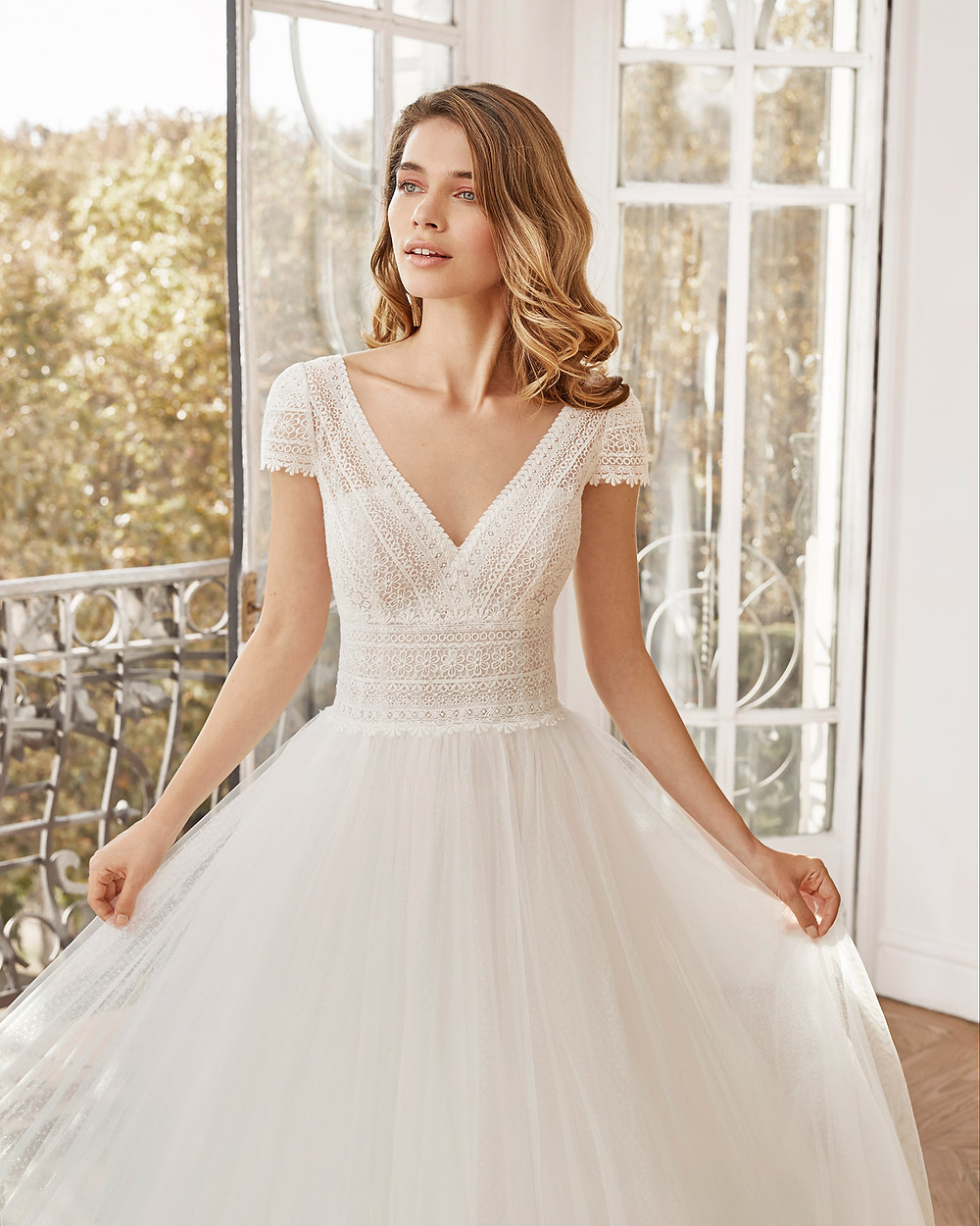 An Aire Barcelona 2020 lace and tulle A-line wedding dress with cap sleeves