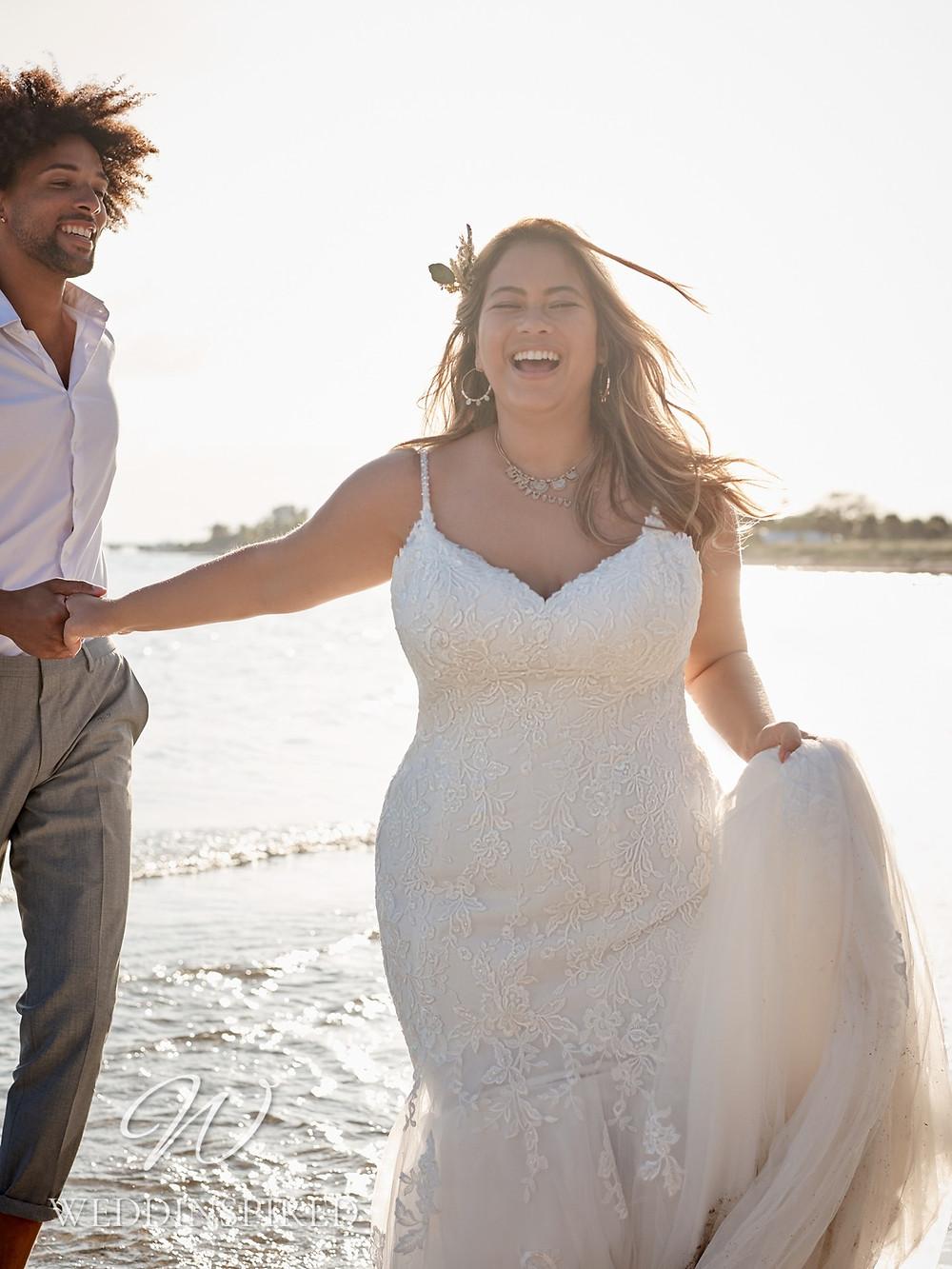 A Rebecca Ingram 2021 plus size lace mermaid wedding dress