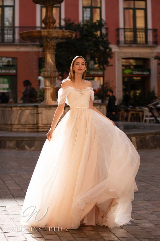 A Nora Naviano 2021 blush tulle off the shoulder A-line wedding dress