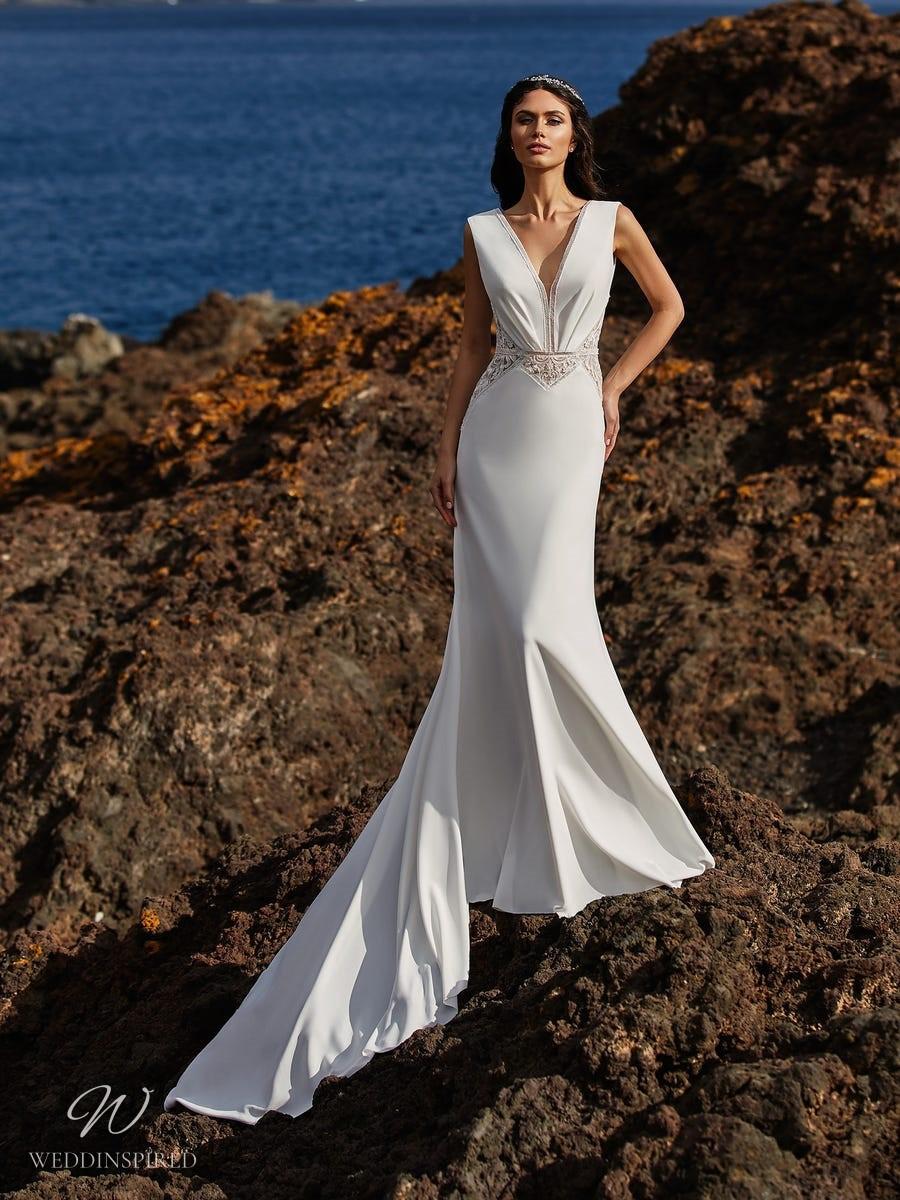 A Pronovias 2021 simple column wedding dress with a v neckline and a train