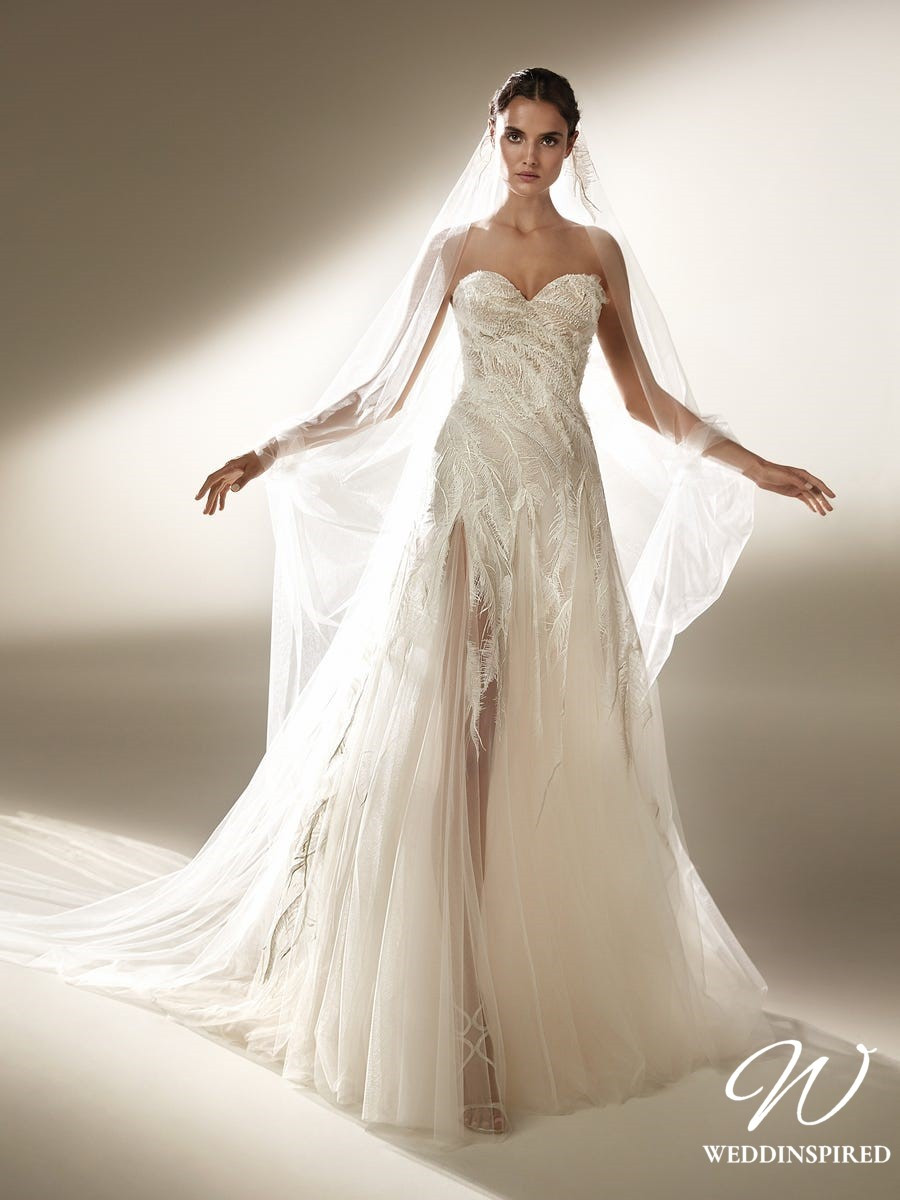 An Atelier Pronovias princess ball gown wedding dress with feathers, a sweetheart neckline and a tulle skirt