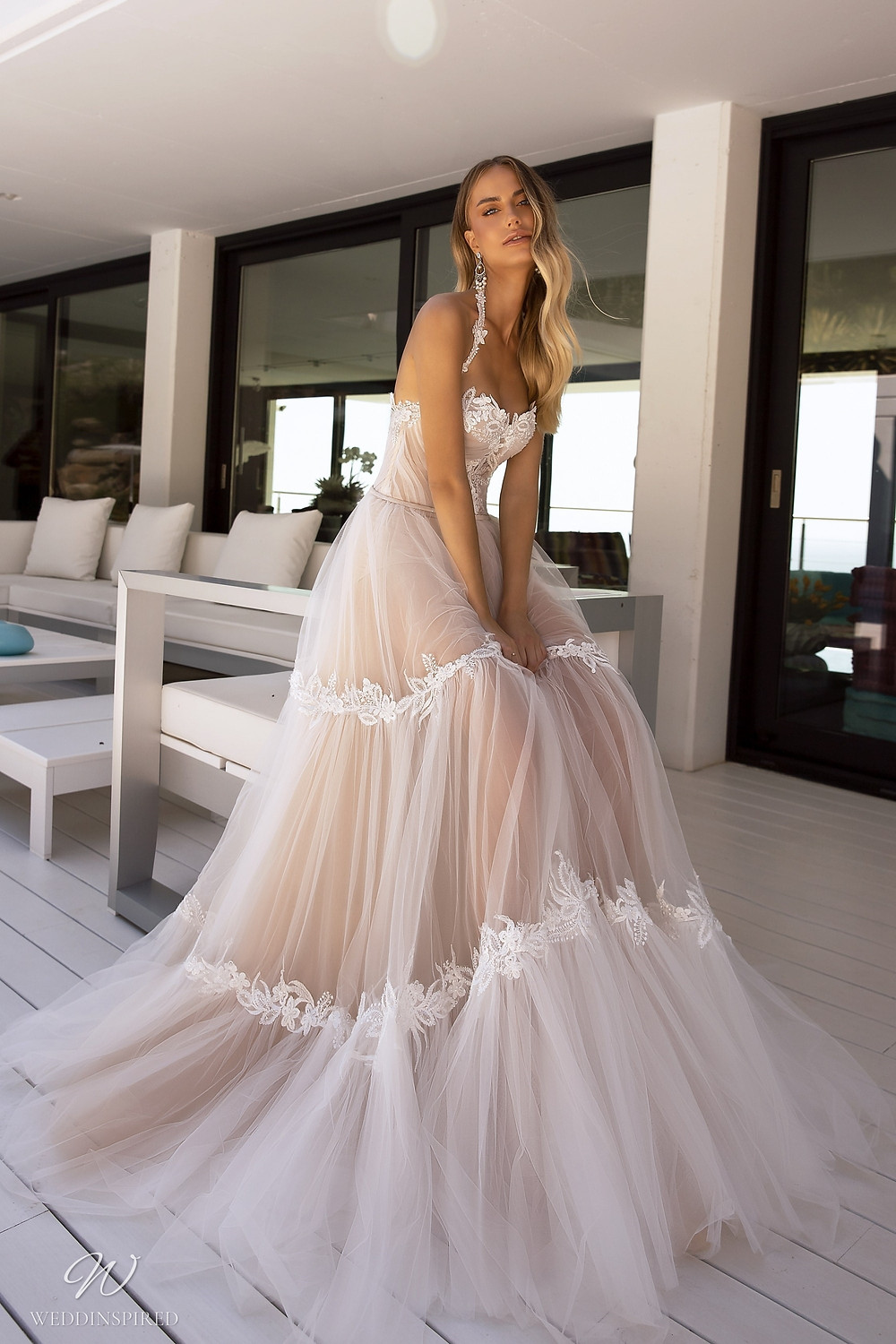 A Tina Valerdi strapless blush tulle A-line wedding dress with a sweetheart neckline
