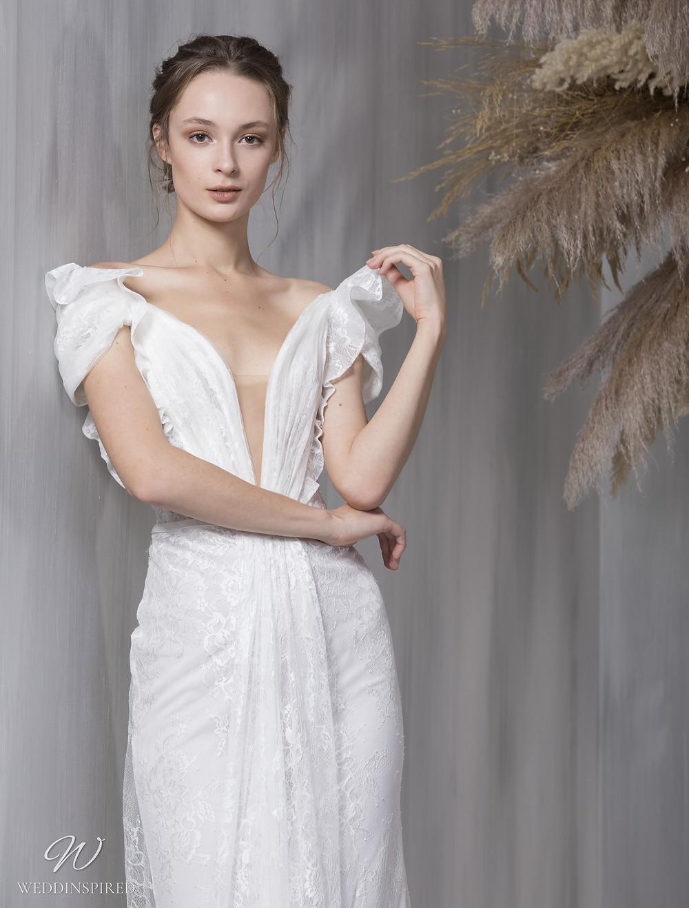A Tony Ward 2021 lace mermaid wedding dress with a v neck and short ruffle sleeves