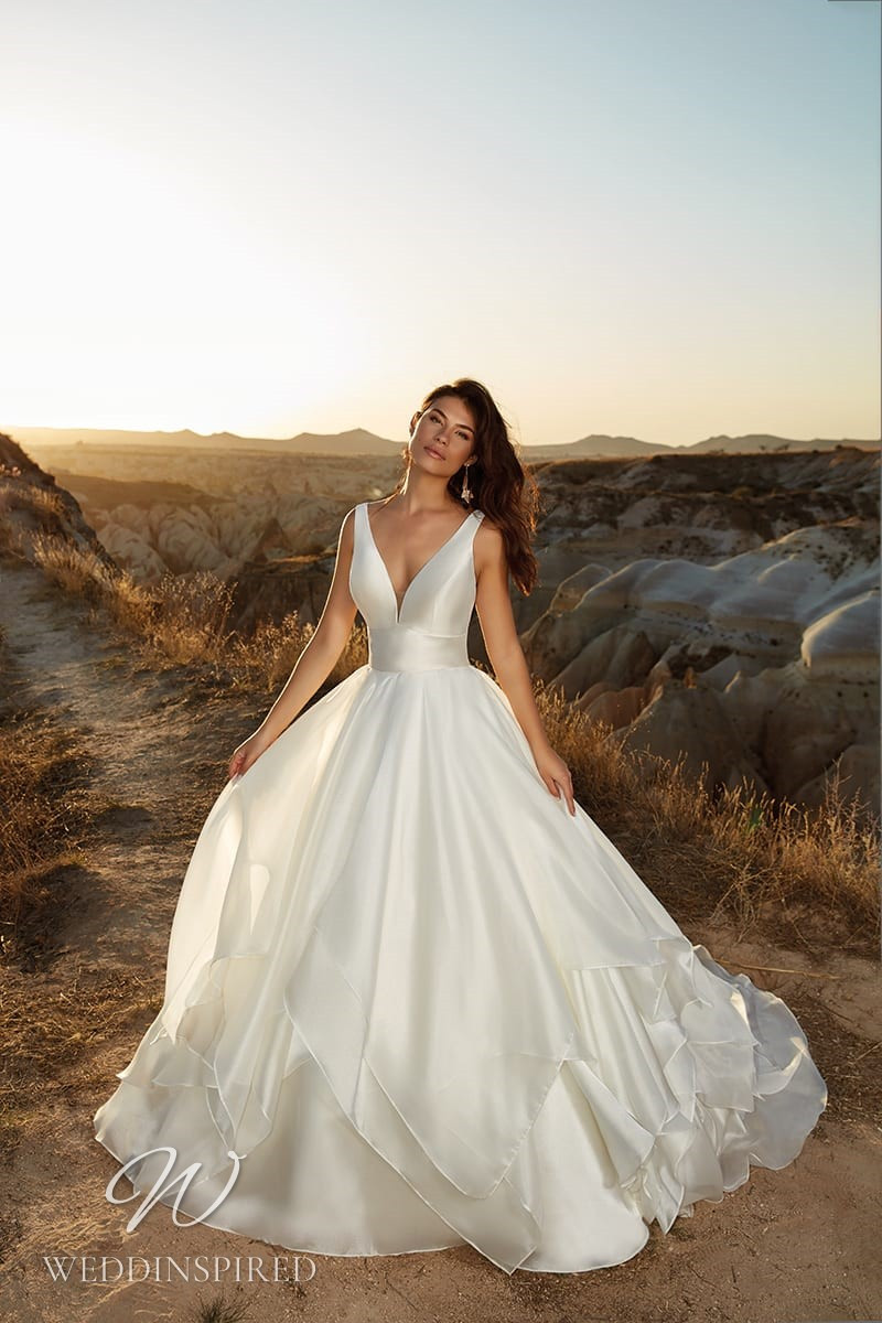 An Eddy K 2021 satin princess ball gown wedding dress with a v neck