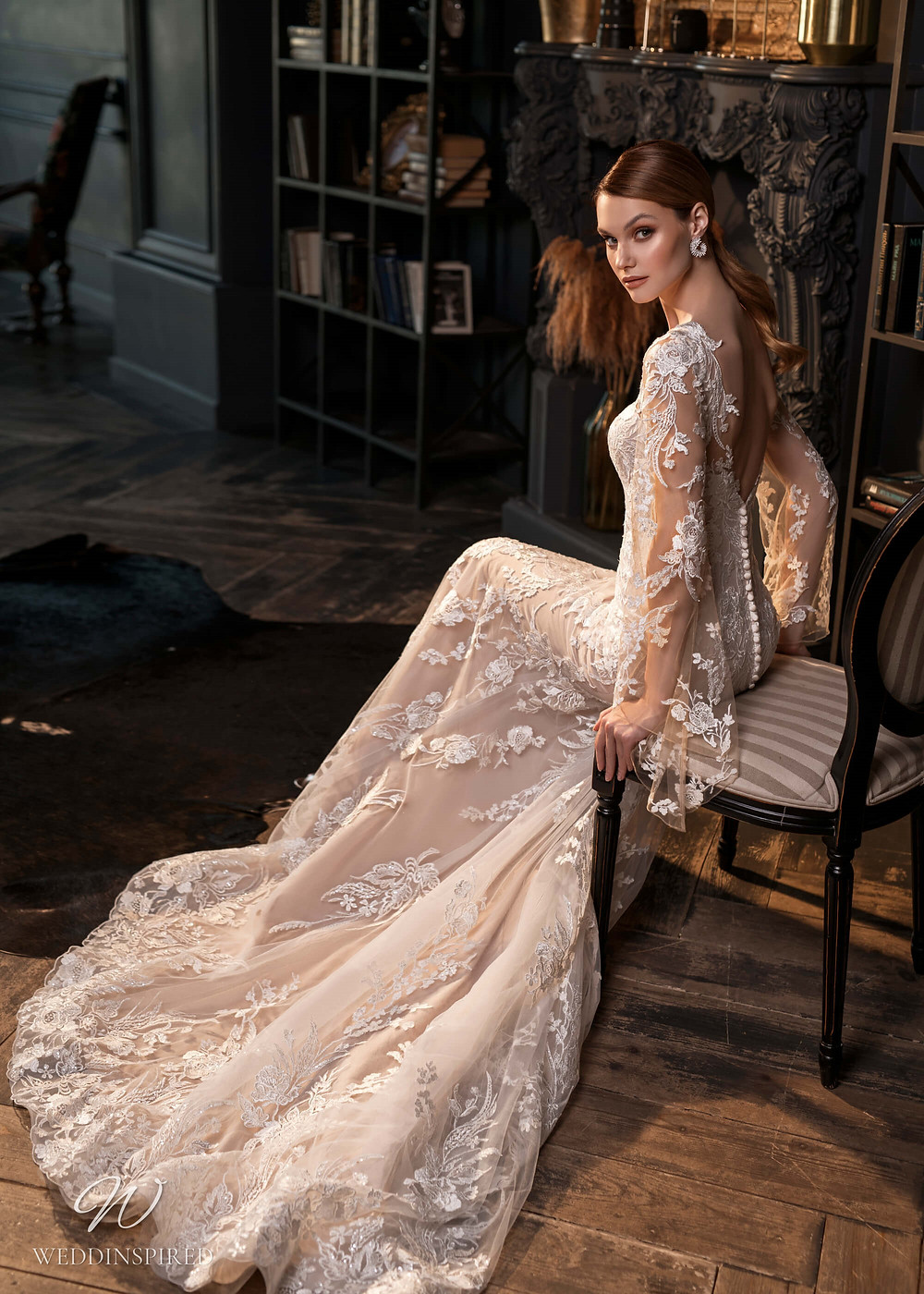 A Naviblue Bridal 2021 blush lace and mesh mermaid fit and flare wedding dress with long illusion sleeves