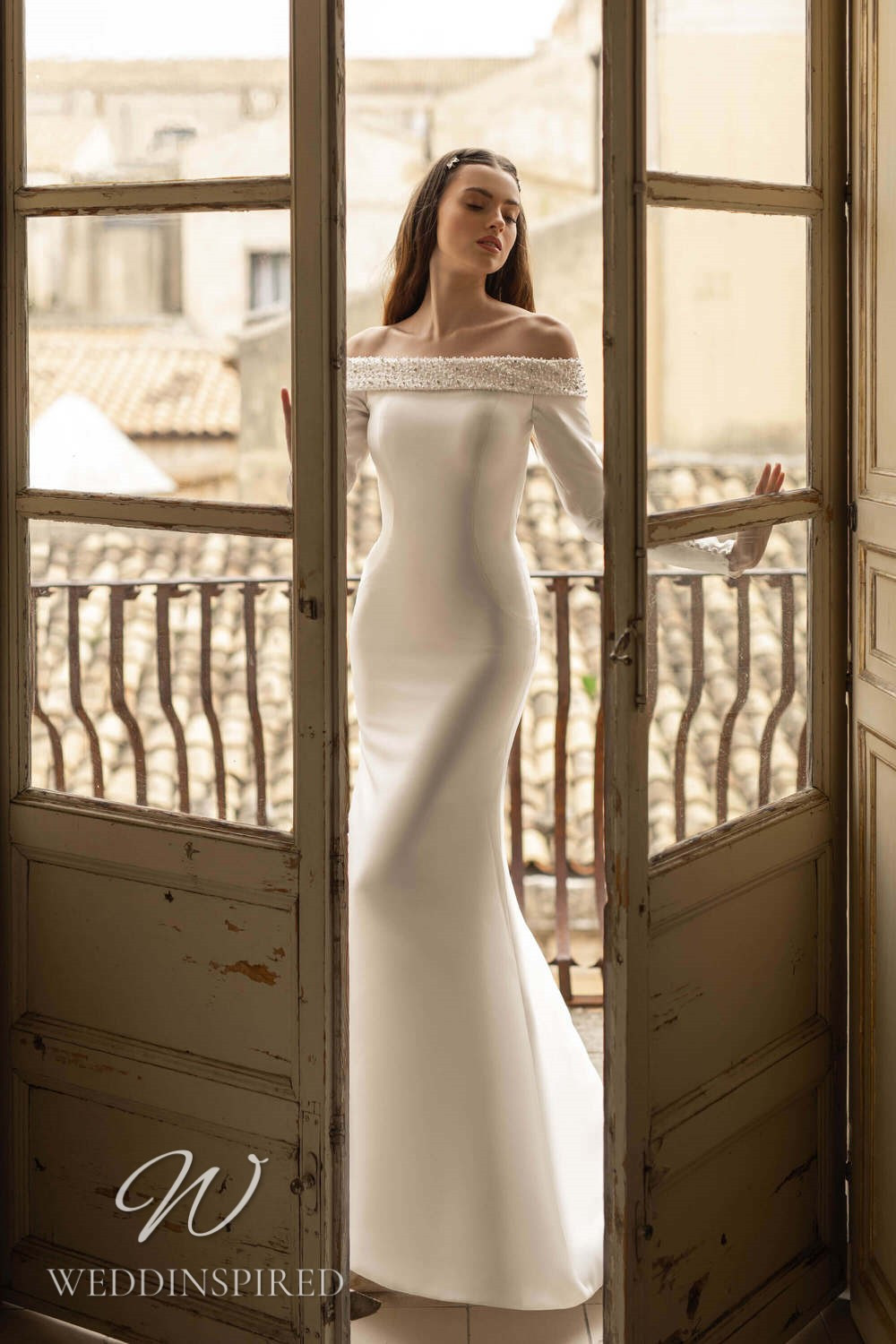 A Lussano 2021 off the shoulder satin mermaid wedding dress with long sleeves