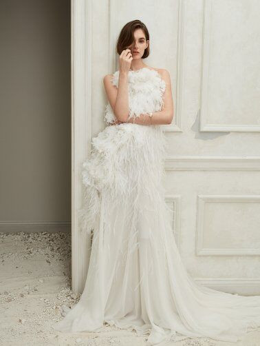 An Oscar de la Renta feather and crepe A-line wedding dress