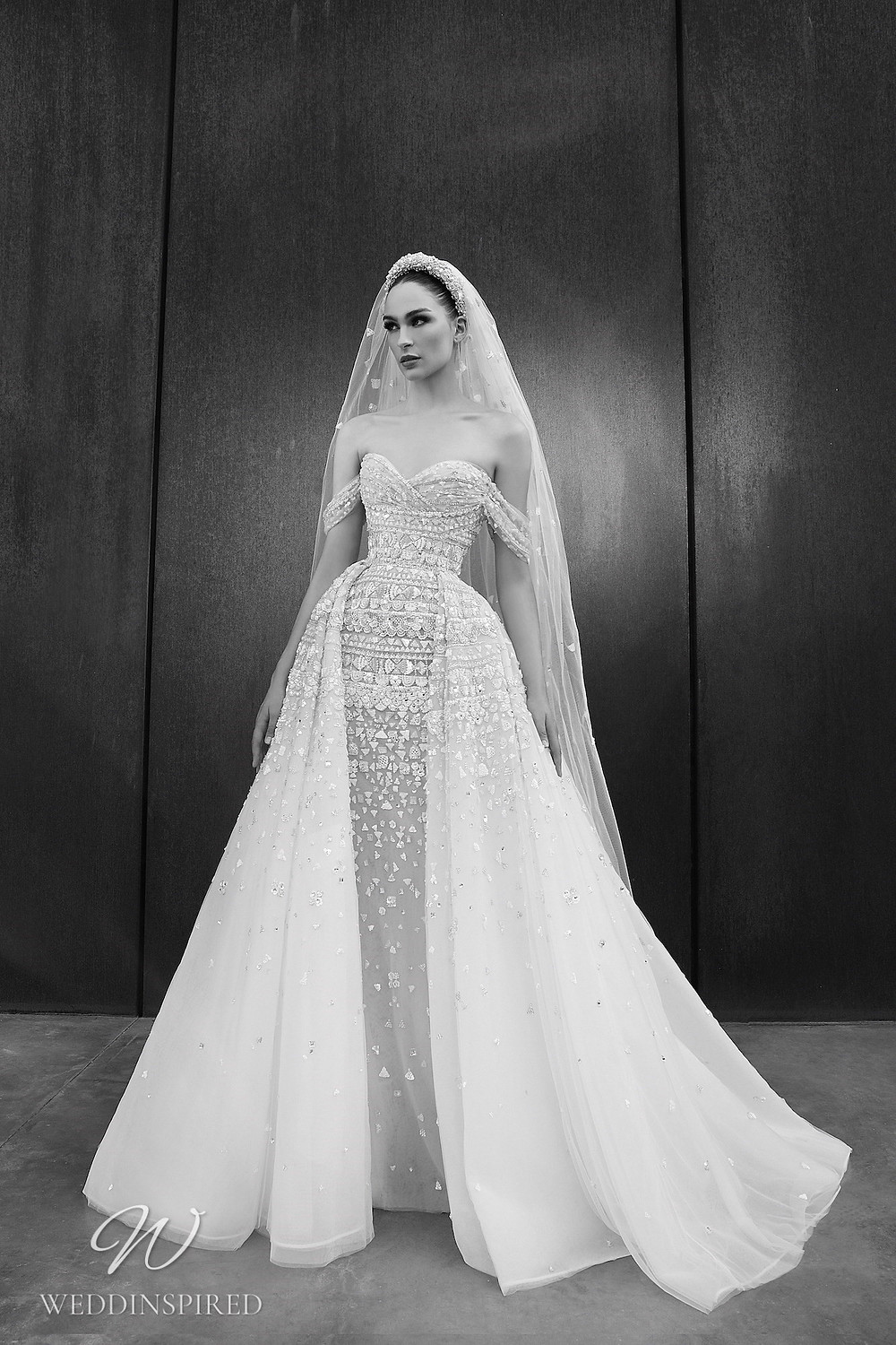 A Zuhair Murad Spring 2022 sparkly off the shoulder tulle ball gown wedding dress