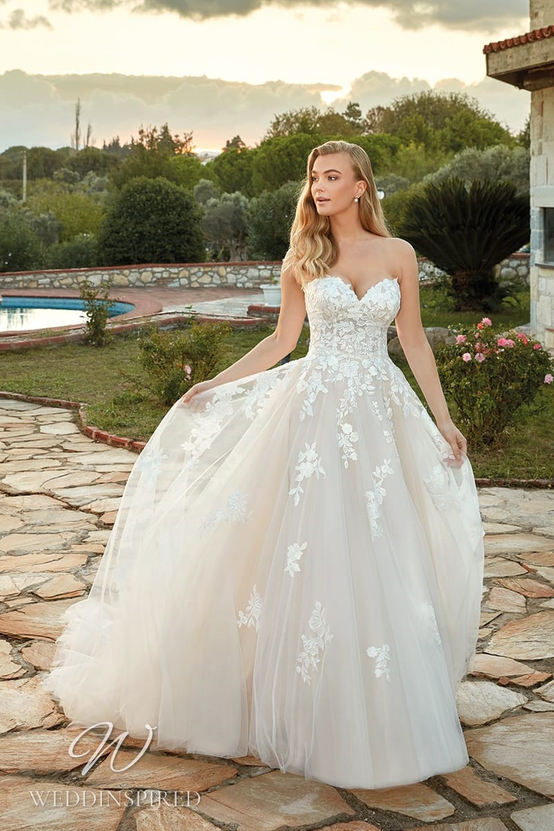 An Eddy K 2022 strapless lace and tulle A-line wedding dress