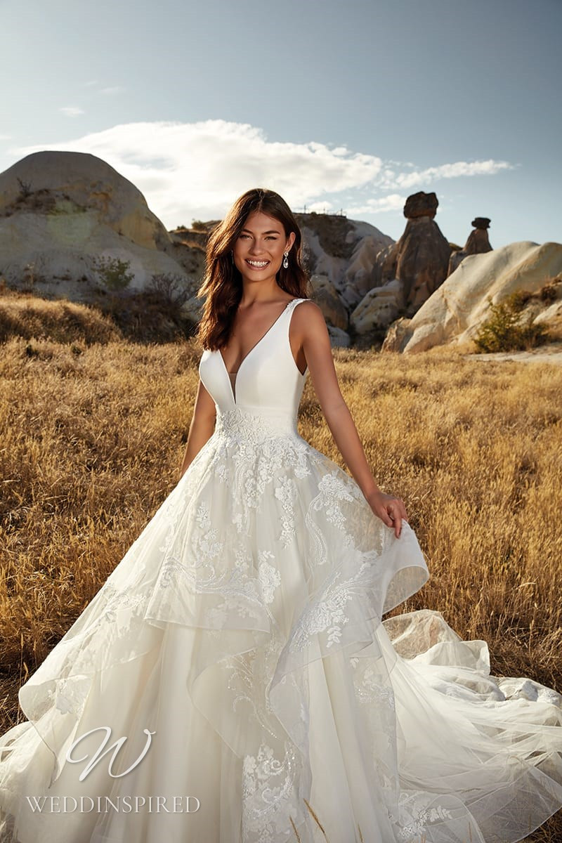 An Eddy K 2021 lace satin and tulle princess ball gown wedding dress with a v neck
