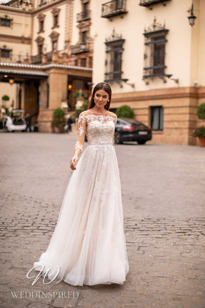A Nora Naviano 2021 lace and tulle off the shoulder A-line wedding dress with long sleeves