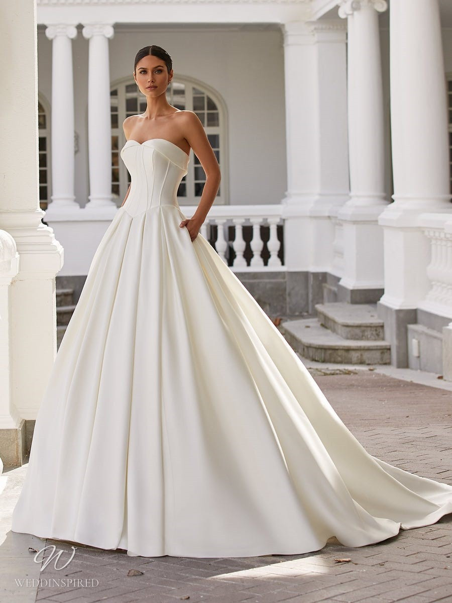 A Pronovias 2021 simple strapless silk ball gown wedding dress with pockets