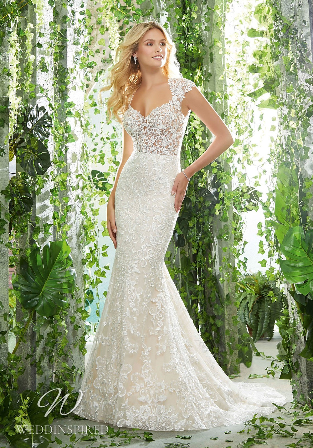 A Madeline Gardner lace mermaid wedding dress with cap sleeves
