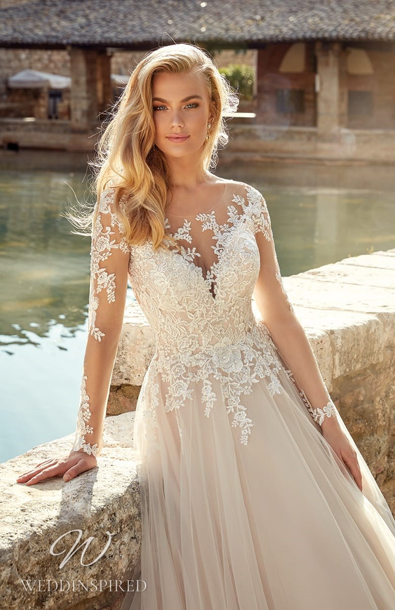 An Eddy K 2021 blush lace and tulle A-line wedding dress with long sleeves