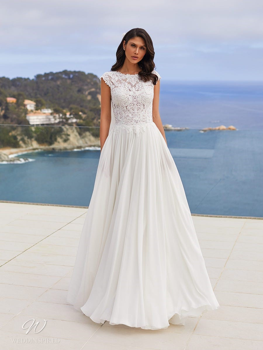 A Pronovias 2021 lace and chiffon A-line wedding dress with cap sleeves