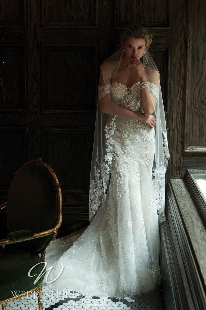 A Justin Alexander 2021 off the shoulder lace mermaid wedding dress