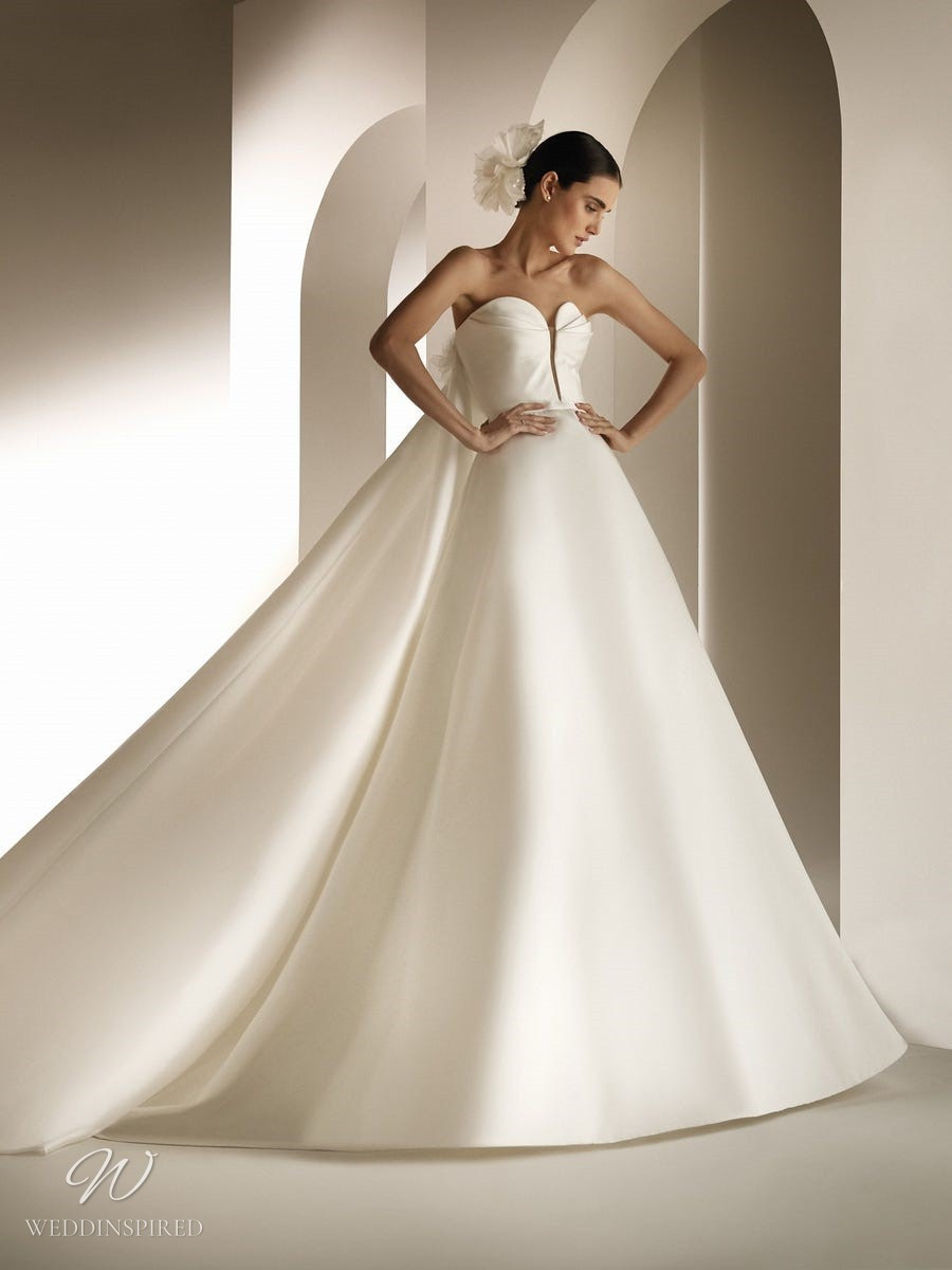 An Atelier Pronovias silk ball gown wedding dress with a sweetheart neckline and a cape