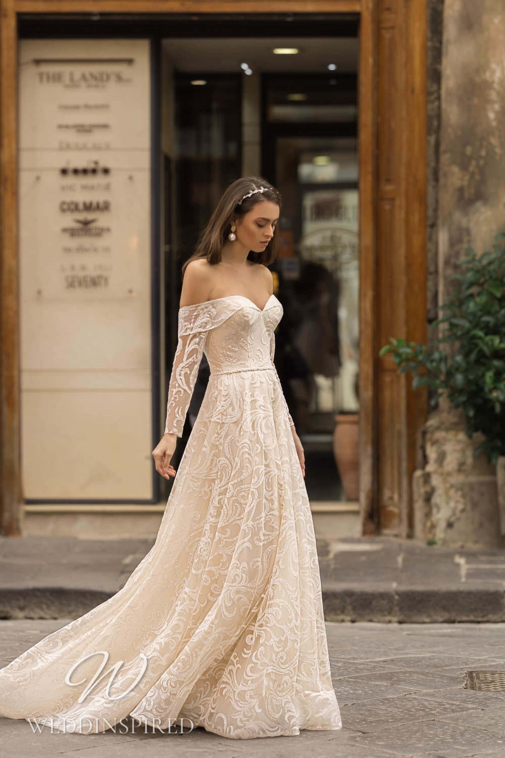 A Lussano 2021 blush off the shoulder A-line wedding dress with long sleeves