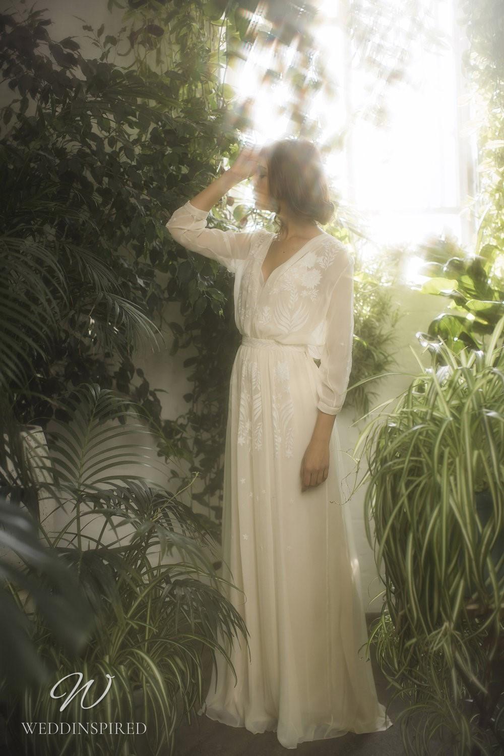 An Olwen Bourke soft flowy chiffon sheath wedding dress with long sleeves and a v neck