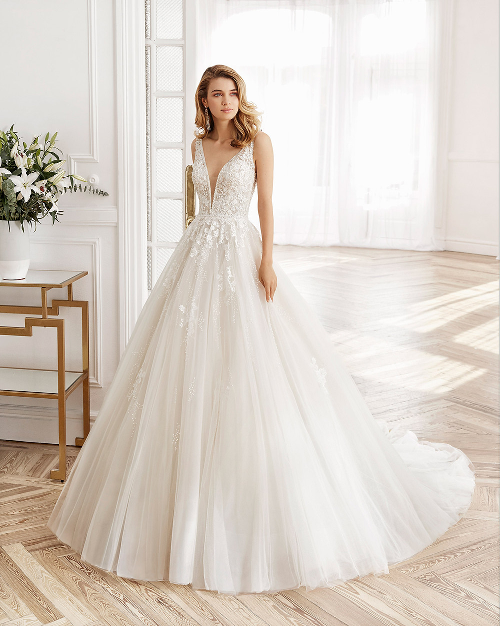 An Aire Barcelona 2020 lace and tulle princess ball gown wedding dress with a v neckline