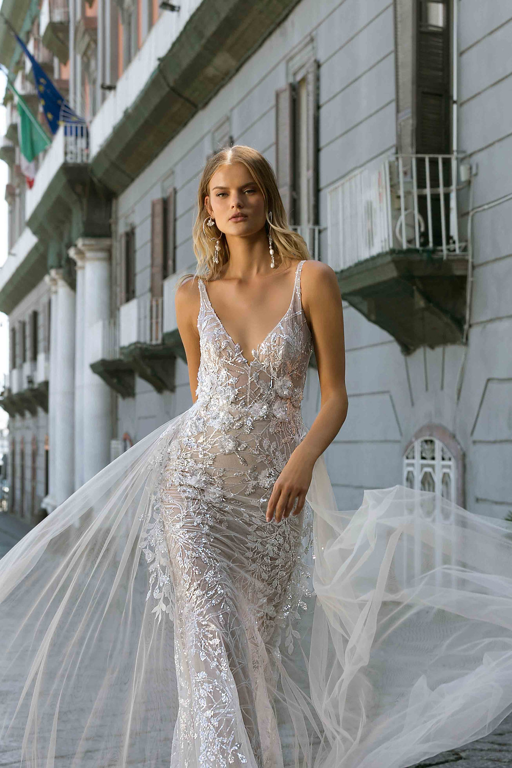 A lace mermaid wedding dress, with crystals, thin straps, deep v neckline and tulle detachable skirt