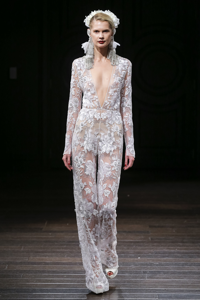 A Naeem Khan lace wedding jumpsuit or pantsuit with long sleeves