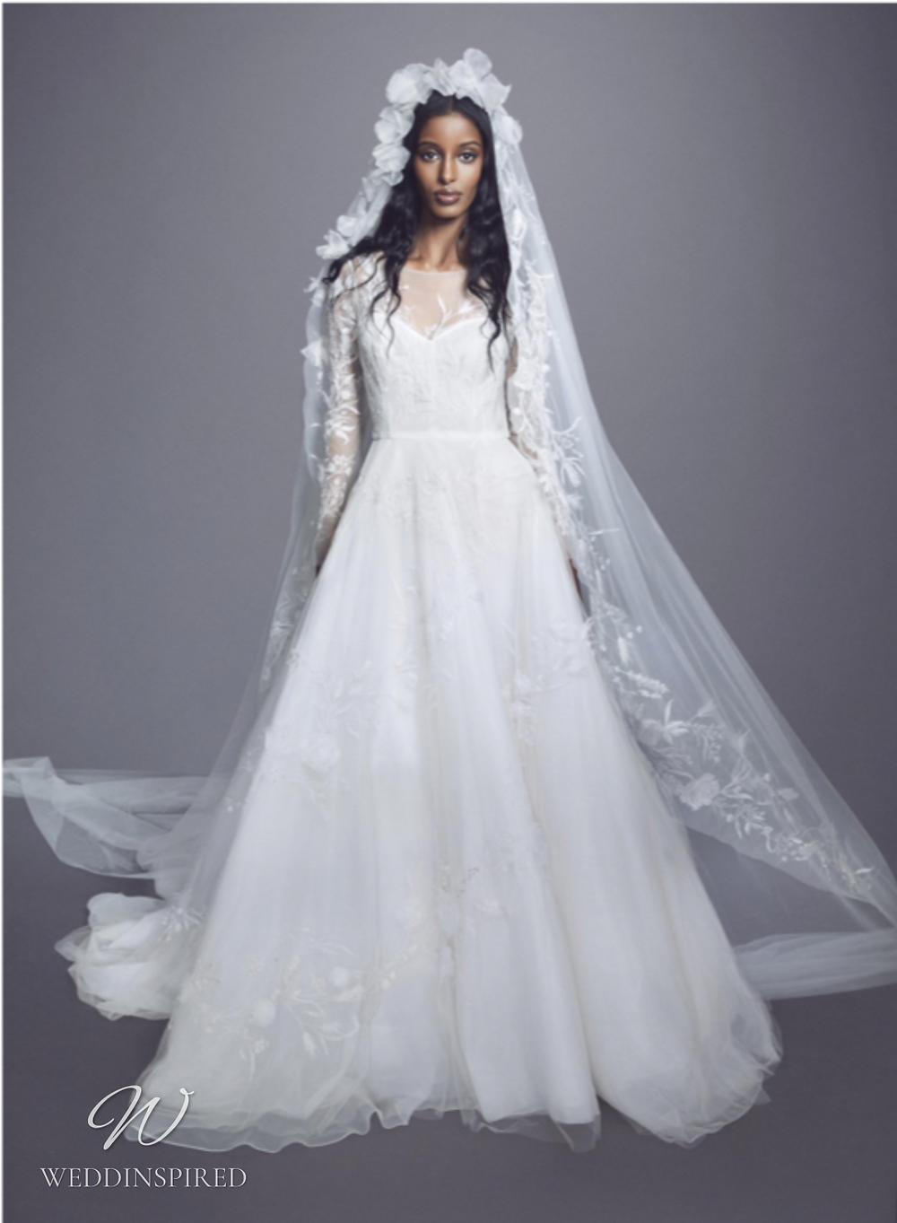 A Marchesa Fall 2021 mesh and lace A-line wedding dress with long illusion sleeves
