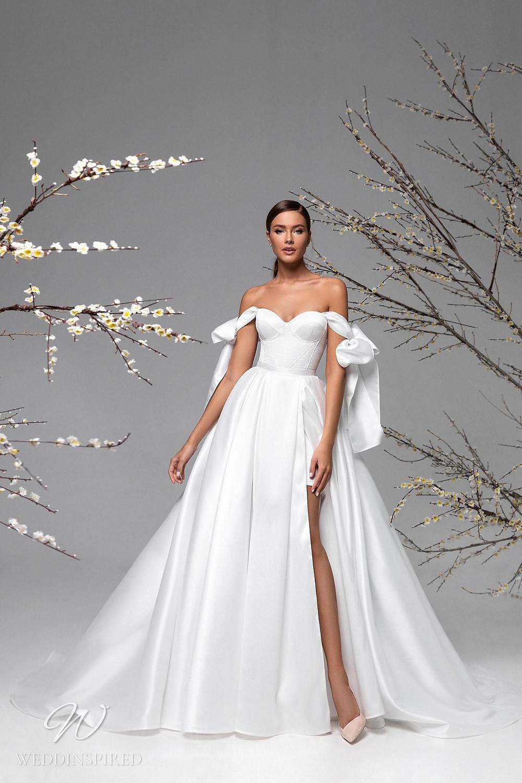 A Ricca Sposa simple silk satin ball gown wedding dress with a slit