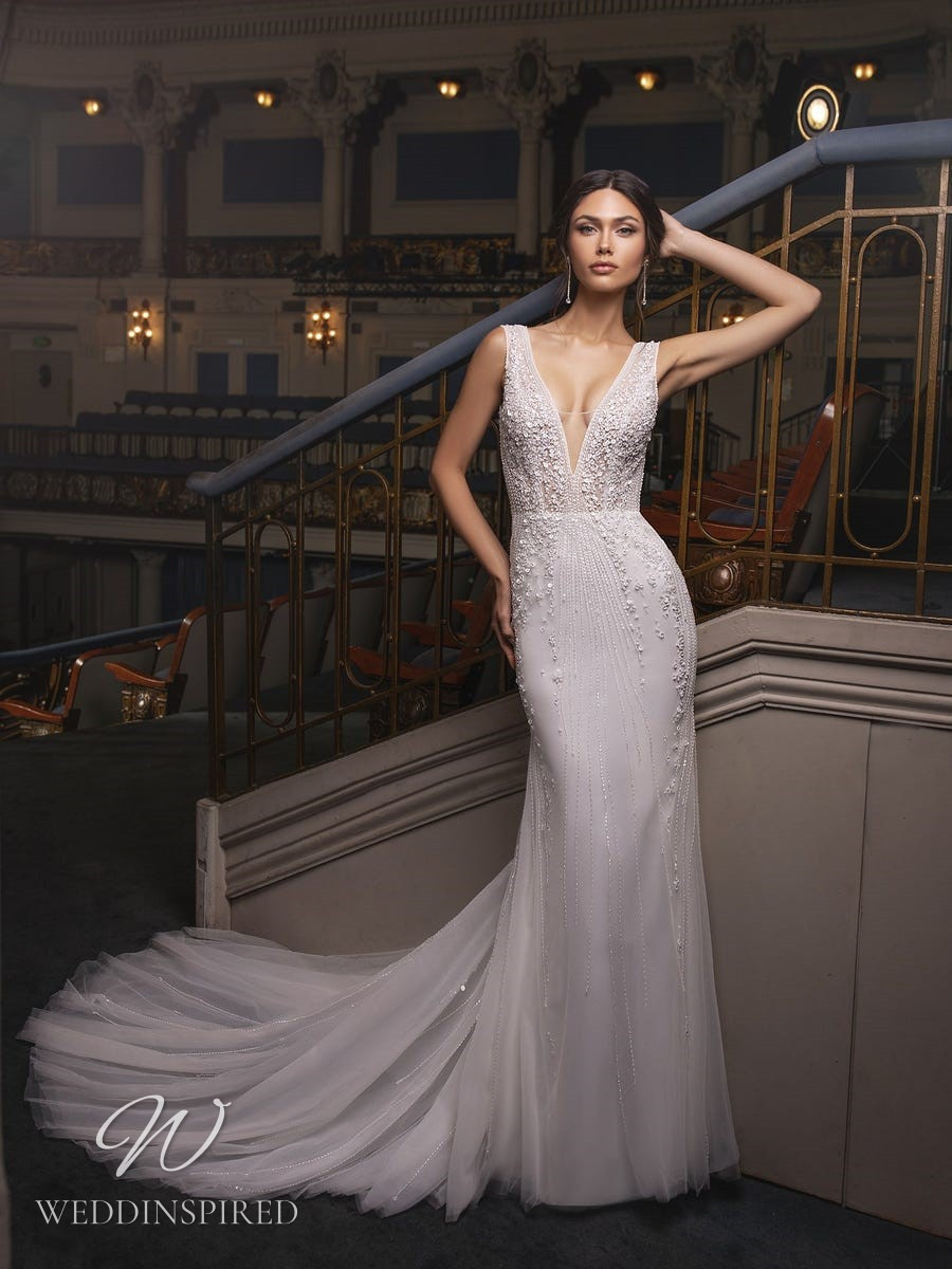 A Pronovias Privée 2021 sparkly tulle mermaid wedding dress with a v neck