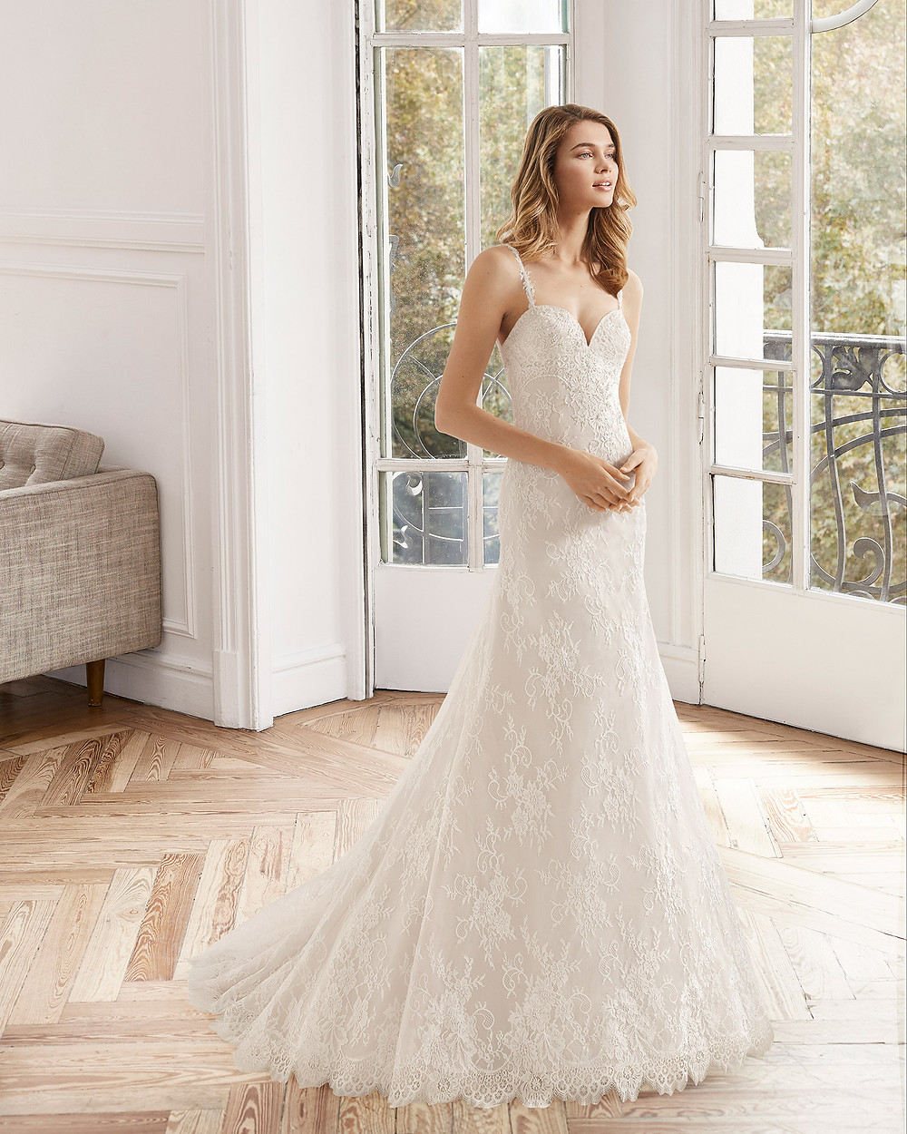 An Aire Barcelona 2020 lace mermaid wedding dress with a sweetheart neckline and straps