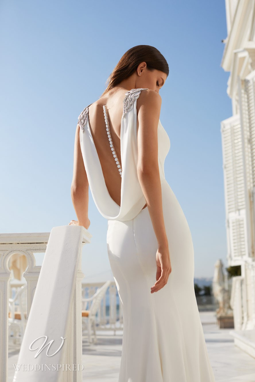 A Milla Nova 2021 satin wedding dress with a cowl back and buttons