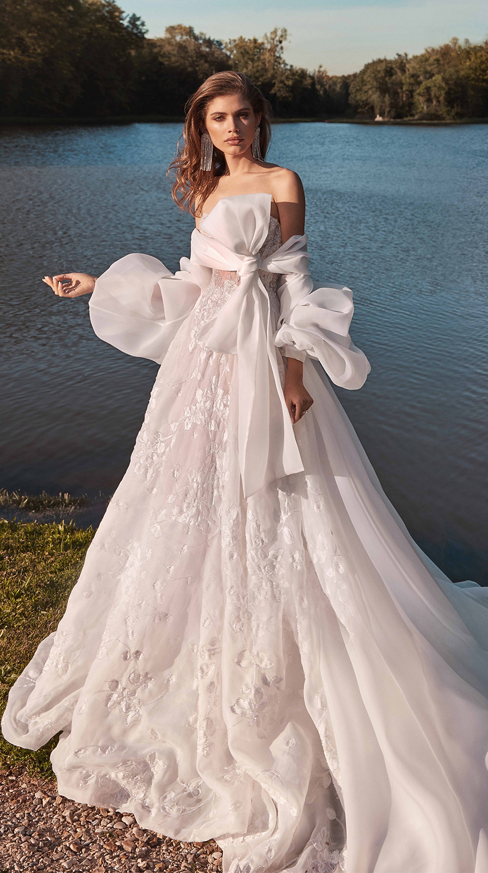 A voluminous coat with balloon sleeves that fasten at the neckline with an oversized statement bow, an elegant add on to any Couture collection wedding gown