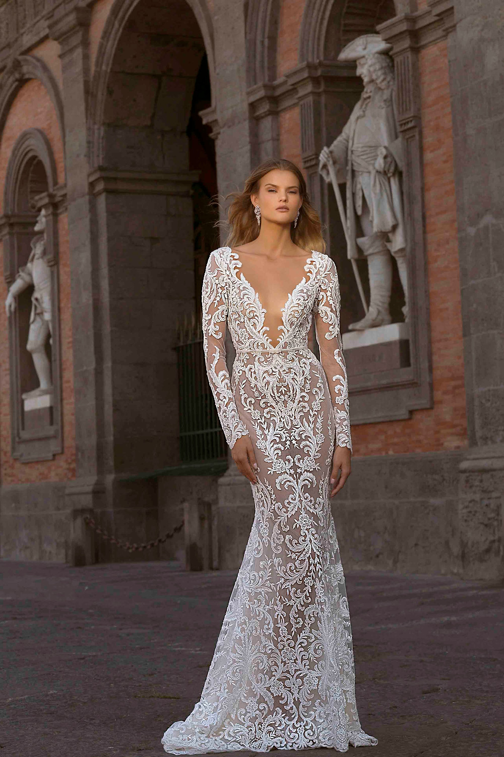 A lace mermaid wedding dress, with long illusion sleeves and low v neckline