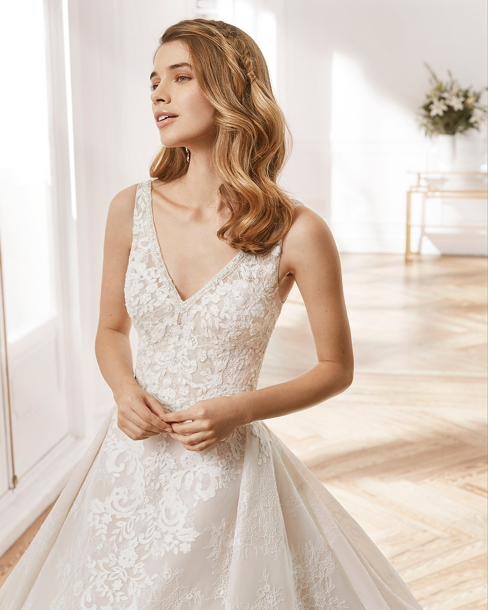 An Aire Barcelona 2020 lace ball gown wedding dress with a v neckline