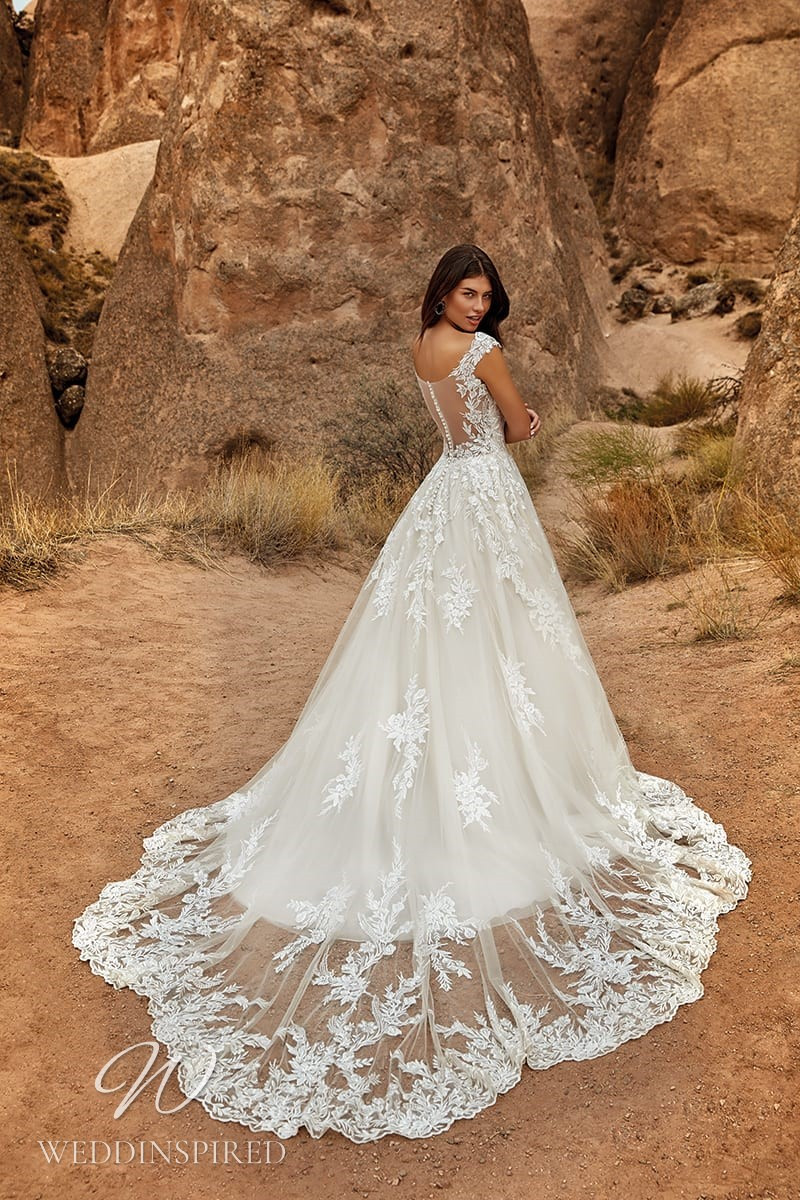 An Eddy K 2021 lace and tulle A-line wedding dress with cap sleeves