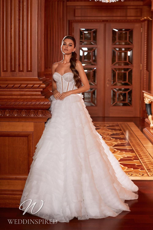 A Pollardi 2021 strapless tulle A-line wedding dress with a ruffle skirt