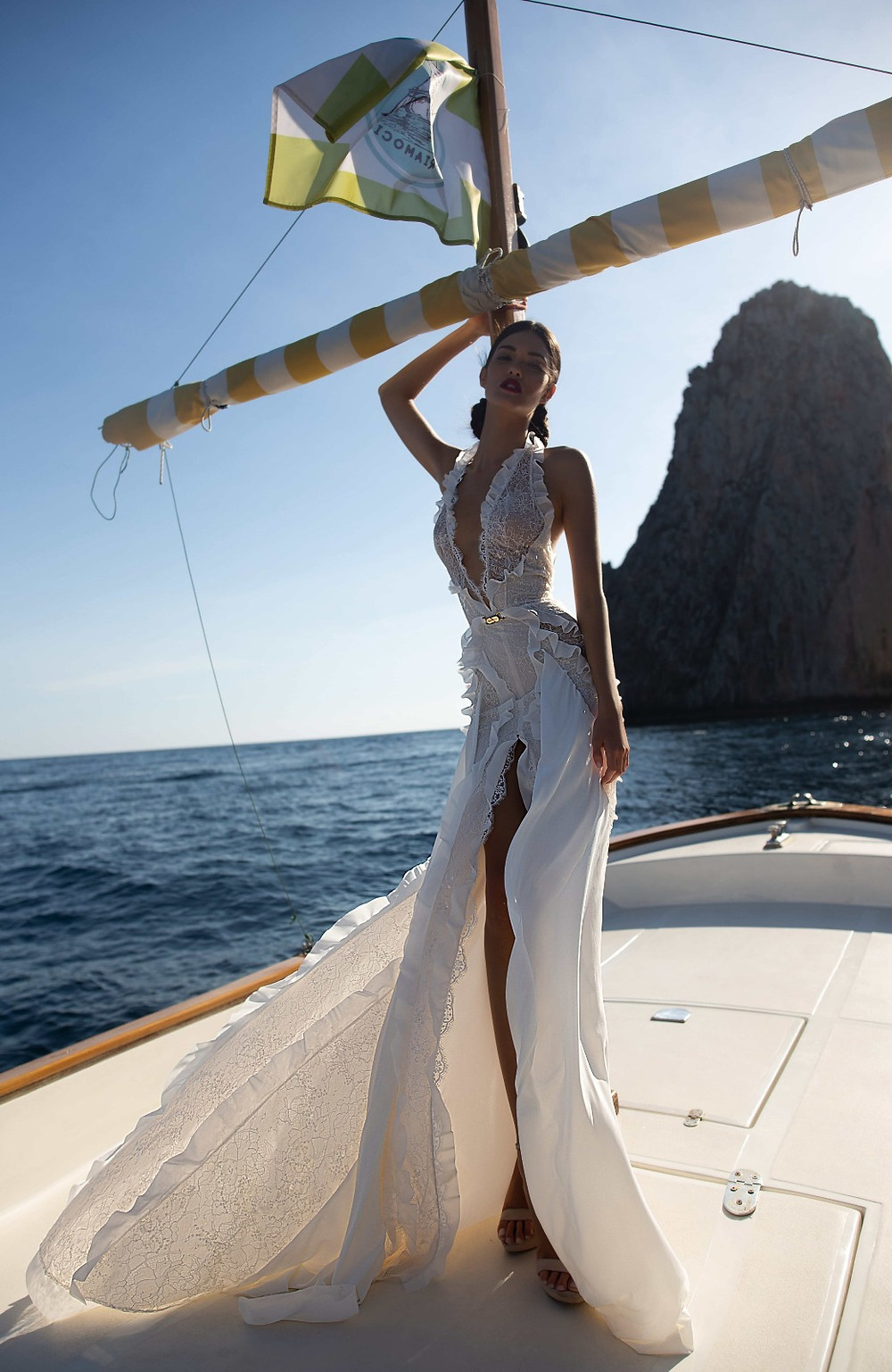 An Inbal Dror halterneck sexy wedding dress with a high slit