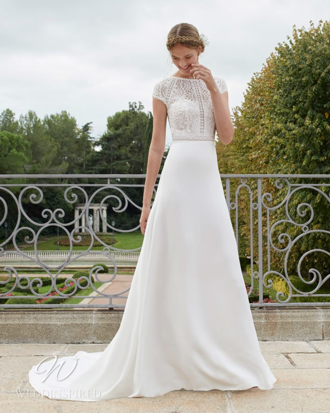 An Aire Barcelona 2021 lace and chiffon boho A-line wedding dress with cap sleeves