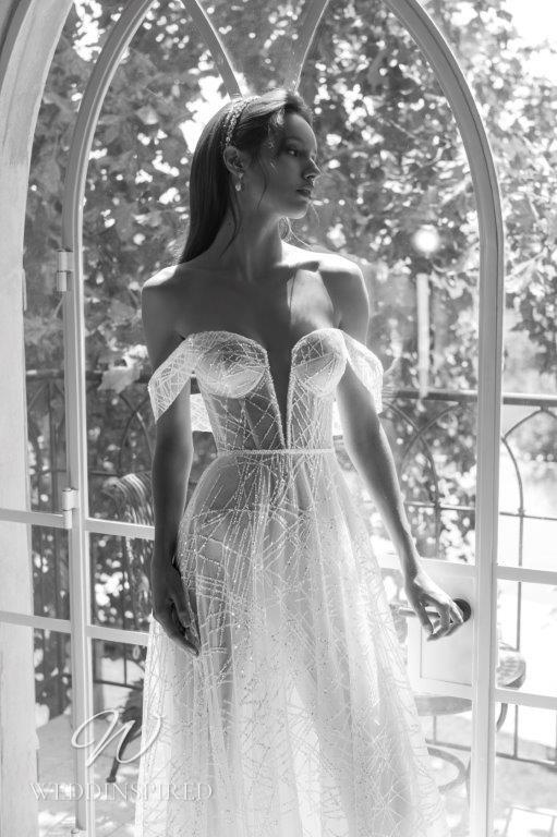 A David Hasbani strapless off the shoulder A-line mesh wedding dress