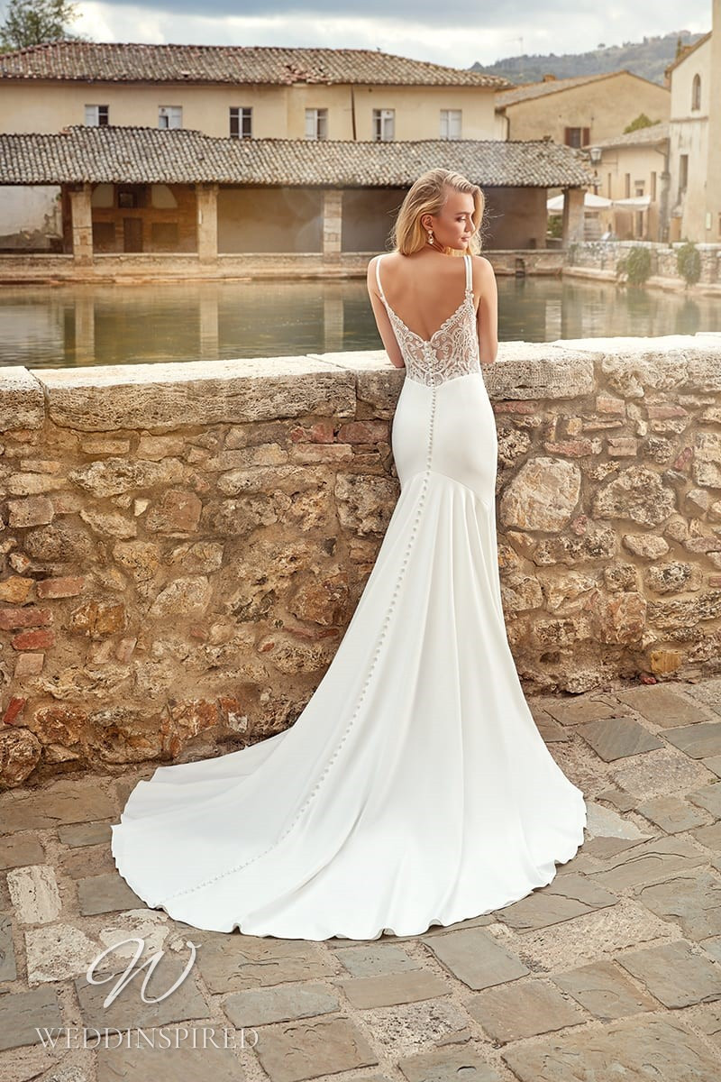 An Eddy K 2021 lace and crepe mermaid wedding dress with a low back