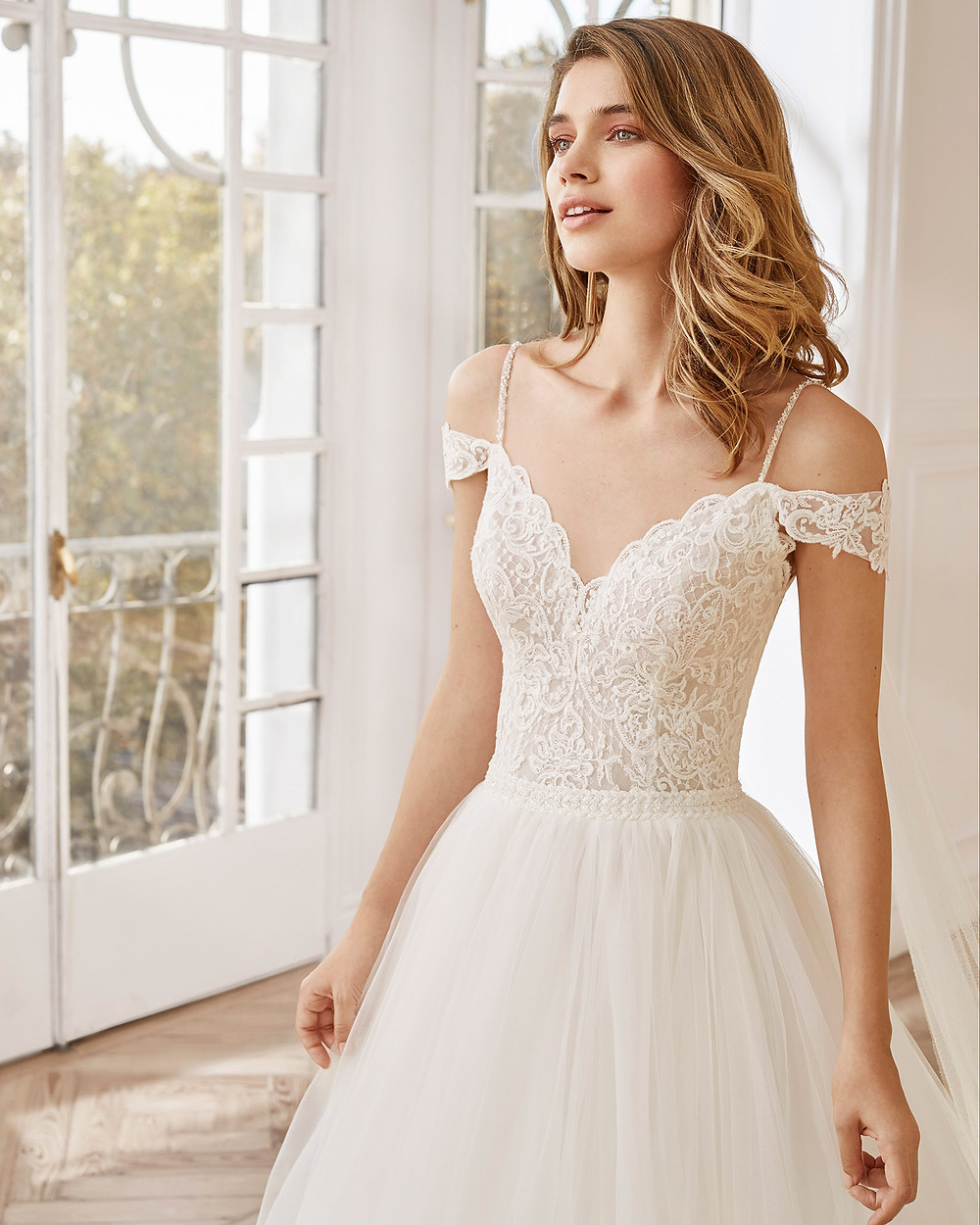 An Aire Barcelona 2020 lace and tulle off the shoulder A-line wedding dress