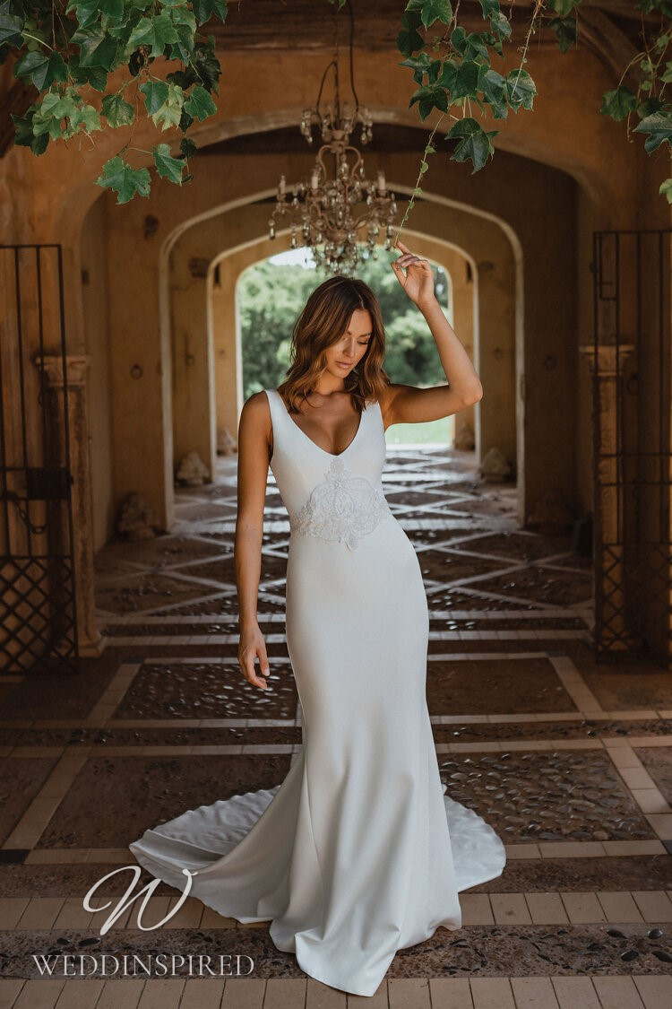 An Anna Campbell 2021 crepe and lace mermaid wedding dress with a v neck