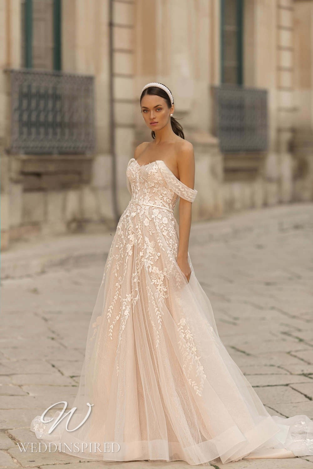 A Lussano 2021 blush lace and tulle off the shoulder A-line wedding dress