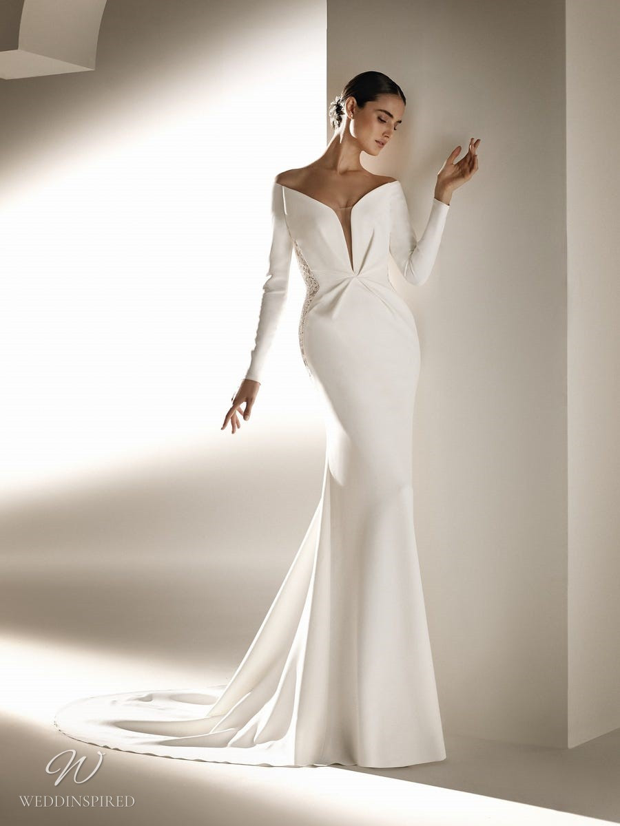 An Atelier Pronovias off the shoulder mermaid wedding dress with long sleeves, lace and a train