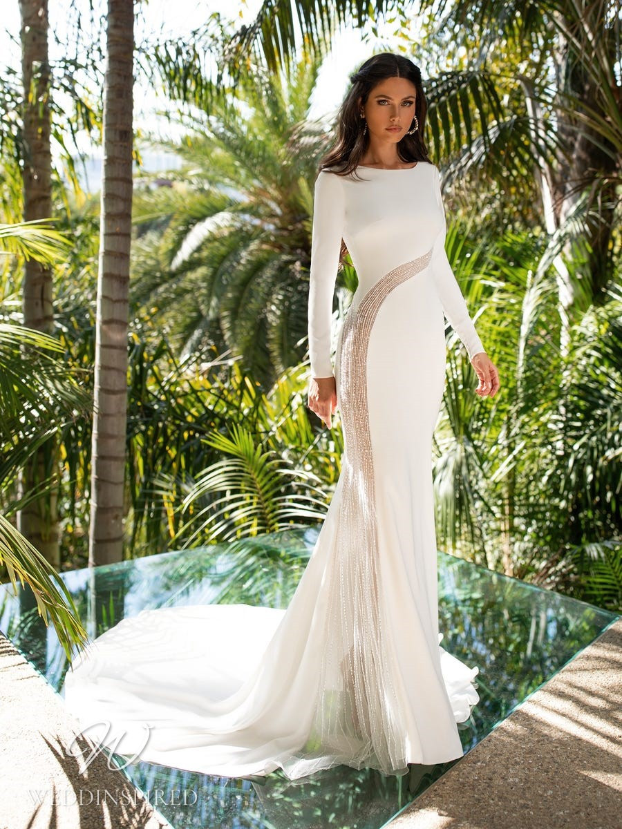 A Pronovias 2021 crepe mermaid wedding dress with long sleeves and a high neckline